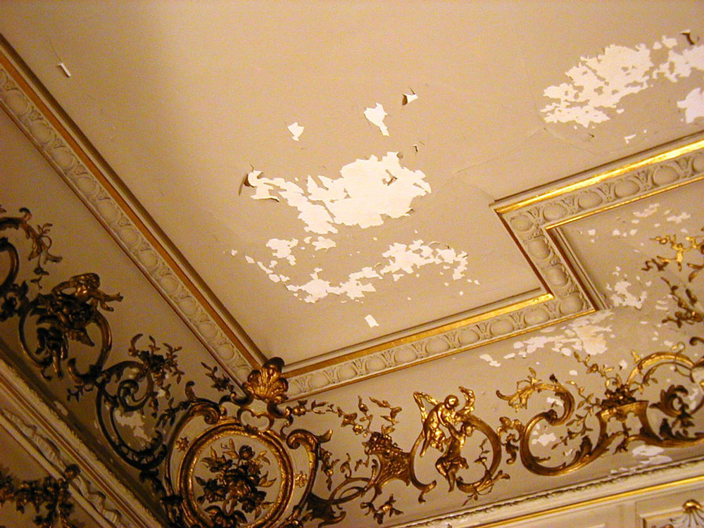 Peeling paint on boudoir ceiling