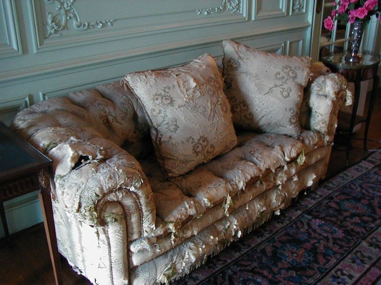 Drawing Room Sofa in tatters
