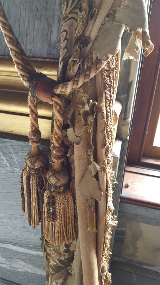 Old curtain tie backs in dining room