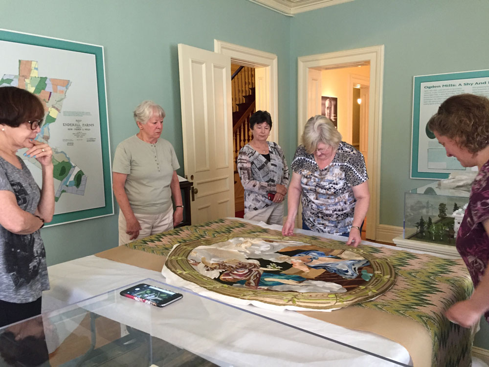 Skykill Embroiderers Inspect the work