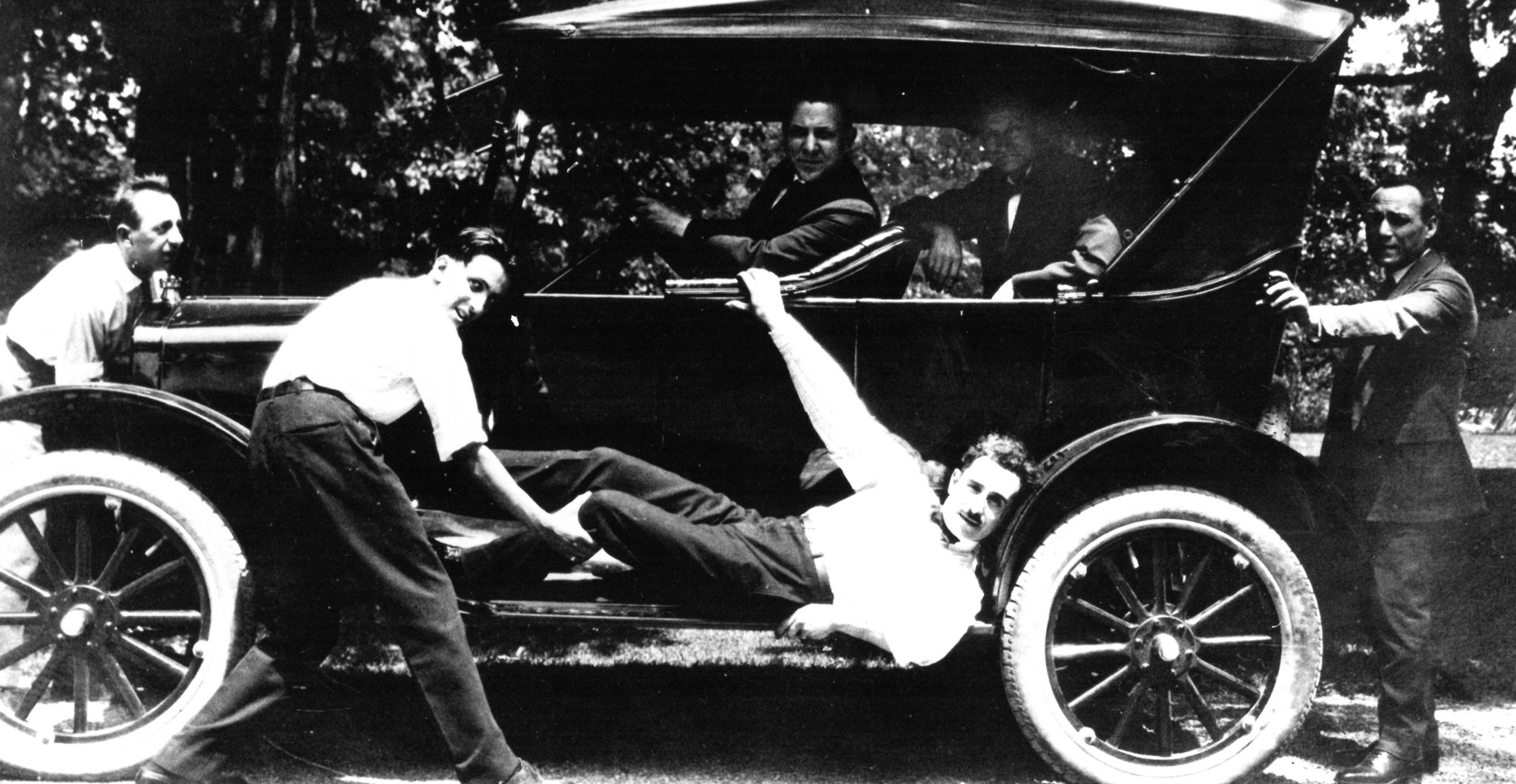 Servants fooling around on a car